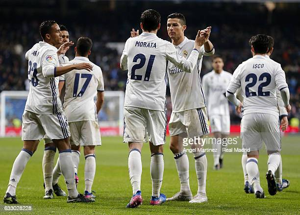 Alvaro Morata of Real Madrid celebrates with Cristiano Ronaldo after scoring their team's third goal during the La Liga match between Real Madrid and...