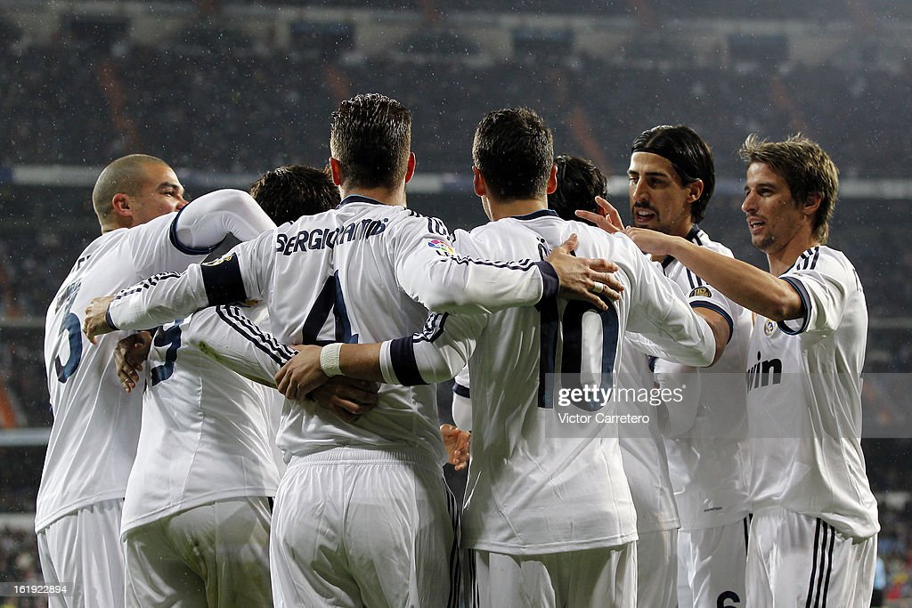 <a gi-track='captionPersonalityLinkClicked' href=/galleries/search?phrase=Alvaro+Morata&family=editorial&specificpeople=6523866 ng-click='$event.stopPropagation()'>Alvaro Morata</a> (2nd L) of Real Madrid celebrates with his team mates after scoring the opening goal during the La Liga match between Real Madrid and Rayo Vallecano at Estadio Santiago Bernabeu on February 17, 2013 in Madrid, Spain.