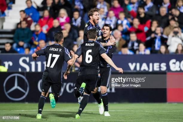 Alvaro Morata of Real Madrid celebrates with teammates Sergio Ramos Lucas Vazquez and Nacho Fernandez during their La Liga match between Deportivo...