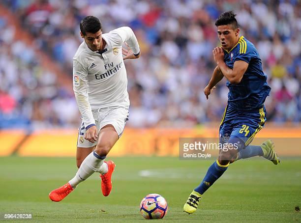 Alvaro Morata of Real Madrid CF battles for the ball against Facundo Roncaglia of RC Celta de Vigo during the La Liga match between Real Madrid CF...