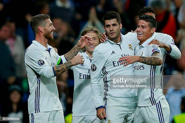 Alvaro Morata of Real Madrid CF celebrates scoring their second goal with teammates James Rodriguez Luka Modric and Sergio Ramos during the UEFA...