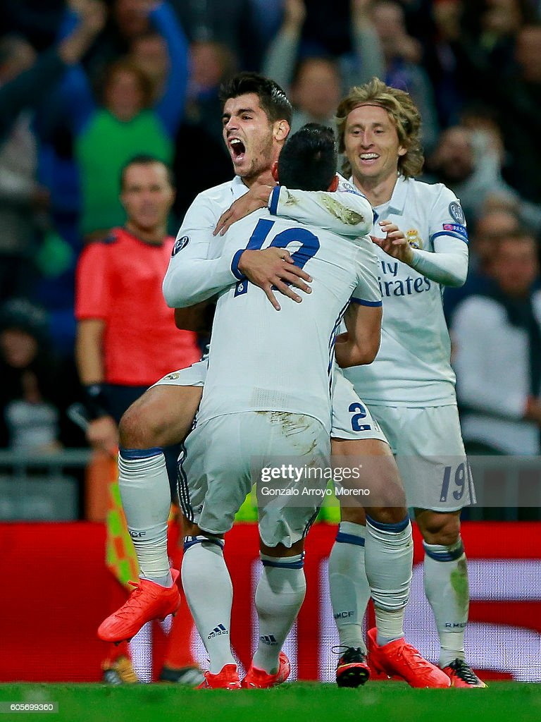 Alvaro Morata (L) of Real Madrid CF celebrates scoring their second goal with teammates James Rodriguez (2ndR) and Luka Modric (R) during the UEFA Champions League group stage match between Real Madrid CF and Sporting Clube de Portugal at Santiago Bernabeu stadium on September 14, 2016 in Madrid, Spain.