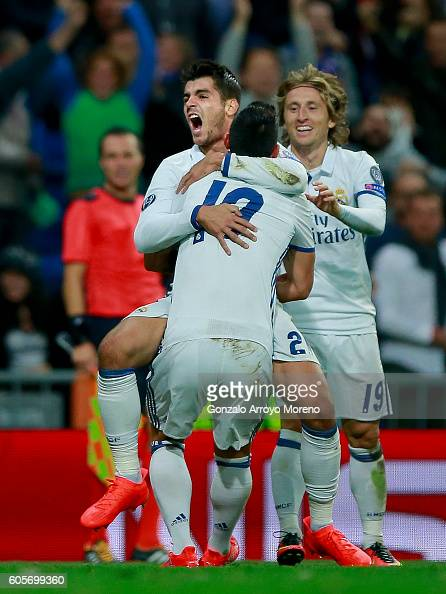 Alvaro Morata of Real Madrid CF celebrates scoring their second goal with teammates James Rodriguez and Luka Modric during the UEFA Champions League...