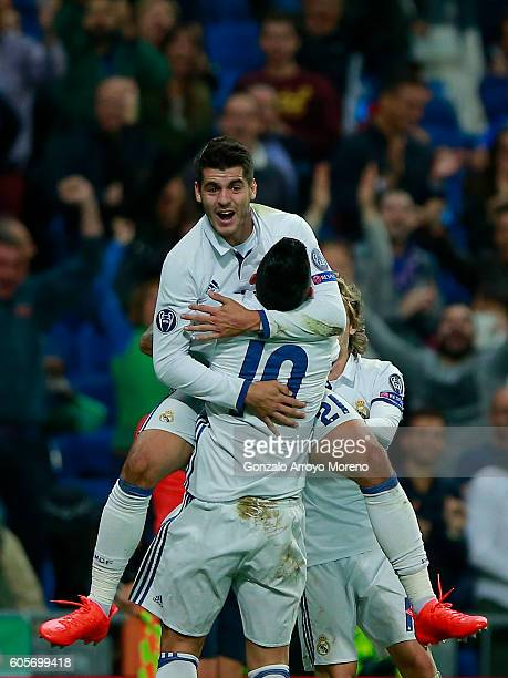Alvaro Morata of Real Madrid CF celebrates scoring their second goal with teammate James Rodriguez during the UEFA Champions League group stage match...