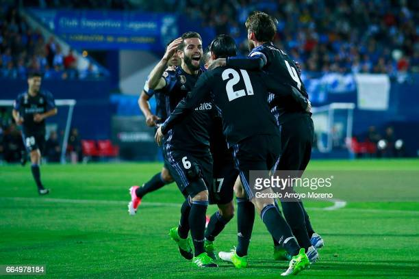Alvaro Morata of Real Madrid CF celebrates scoring their second goal with teammate Sergio Ramos and Nacho Fernandezduring the La Liga match between...