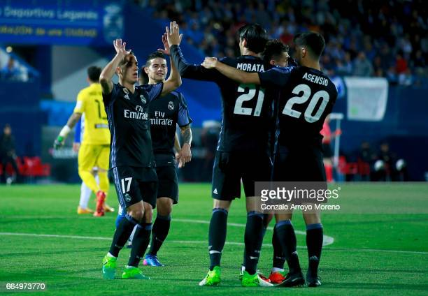 Alvaro Morata of Real Madrid CF celebrates scoring their third goal with teammates during the La Liga match between CD Leganes and Real Madrid CF at...