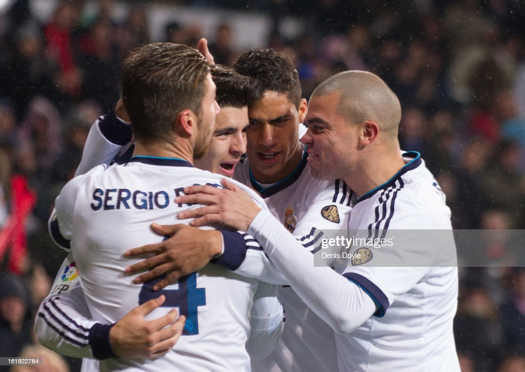 <a gi-track='captionPersonalityLinkClicked' href=/galleries/search?phrase=Alvaro+Morata&family=editorial&specificpeople=6523866 ng-click='$event.stopPropagation()'>Alvaro Morata</a> (2.L) of Real Madrid CF celebrates with Sergio Ramos, Raphael Verane and Pepe (R) after scoring Real's opening goal during the La Liga match between Real Madrid CF and Rayo Vallecano at estadio Santiago Bernabeu on February 17, 2013 in Madrid, Spain.