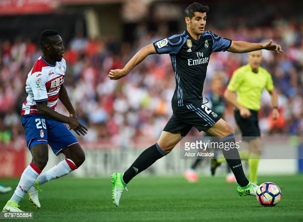 Alvaro Morata of Real Madrid CF competes for the ball with Victorien Angban of Granada CF during the La Liga match between Granada CF v Real Madrid...