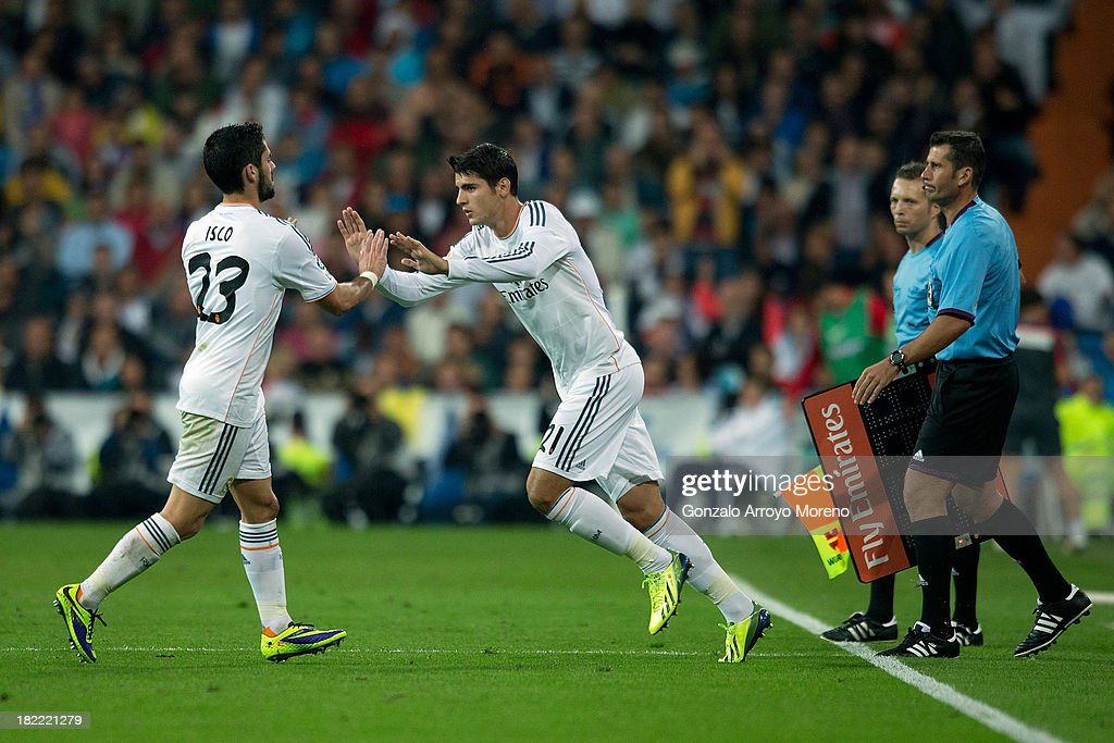 <a gi-track='captionPersonalityLinkClicked' href=/galleries/search?phrase=Alvaro+Morata&family=editorial&specificpeople=6523866 ng-click='$event.stopPropagation()'>Alvaro Morata</a> (R) of Real Madrid CF congratulates his teammate <a gi-track='captionPersonalityLinkClicked' href=/galleries/search?phrase=Isco&family=editorial&specificpeople=5848609 ng-click='$event.stopPropagation()'>Isco</a> (L) during the La Liga match between Real Madrid CF and Club Atletico de Madrid at Estadio Santiago Bernabeu on September 28, 2013 in Madrid, Spain.