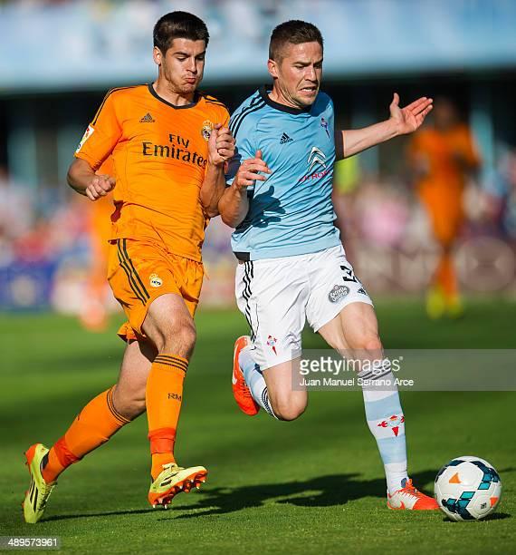 Alvaro Morata of Real Madrid CF duels for the ball with Andreu Fontas of RC Celta De Vigo during the la Liga match between Real Club Celta De Vigo...