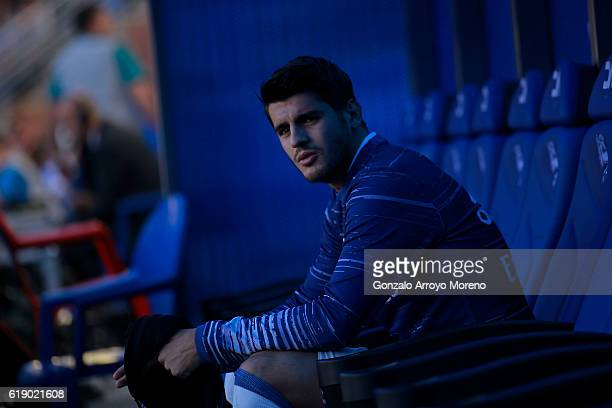 Alvaro Morata of Real Madrid CF gestures as he is fitted on the bench prior to start the La Liga match between Deportivo Alaves and Real Madrid CF at...