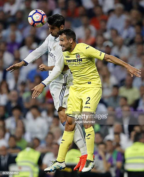 Alvaro Morata of Real Madrid competes for the ball with Mario Perez of Villarreal CF during the La Liga match between Real Madrid CF and Villarreal...