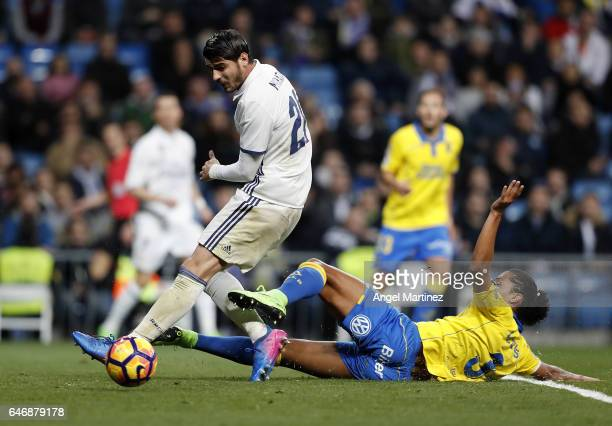 Alvaro Morata of Real Madrid competes for the ball with Mauricio Lemos of UD Las Palmas during the La Liga match between Real Madrid and UD Las...