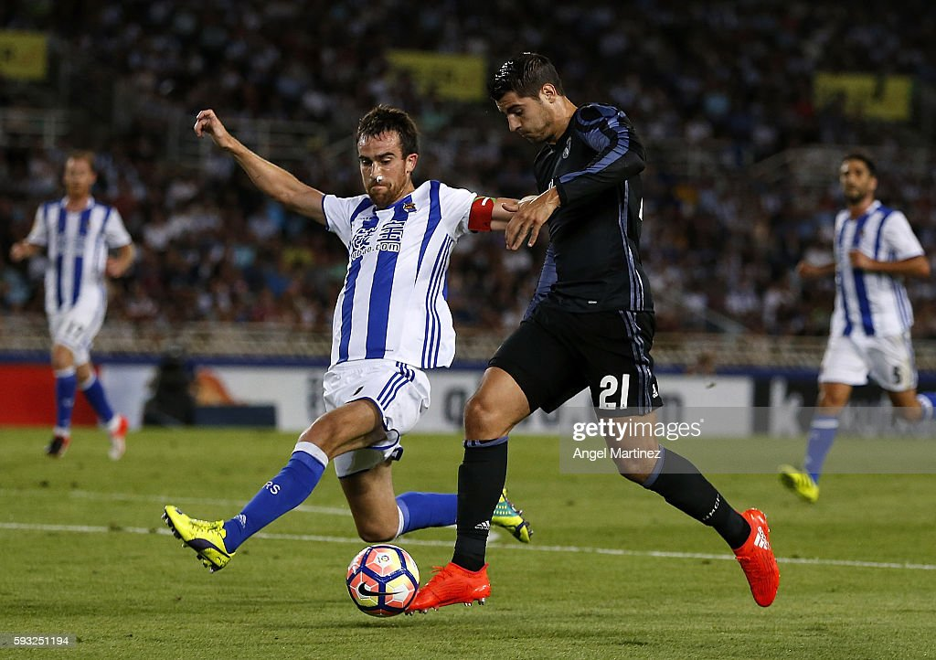 Alvaro Morata of Real Madrid competes for the ball with Mikel Gonzalez of Real Sociedad during the La Liga match between Real Sociedad and Real...