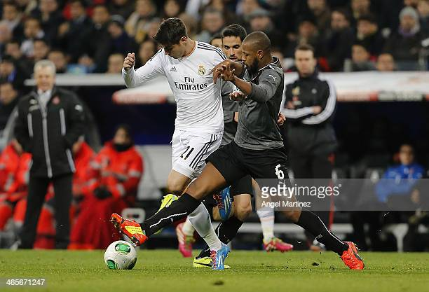 Alvaro Morata of Real Madrid competes for the ball with Sidnei da Silva of Espanyol during the Copa del Rey Quarter Final second leg match between...