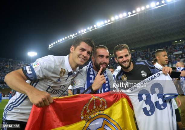 Alvaro Morata of Real Madrid Daniel Carvajal and Nacho Fernandez of Real Madrid celebrate being crowned champions following the La Liga match between...