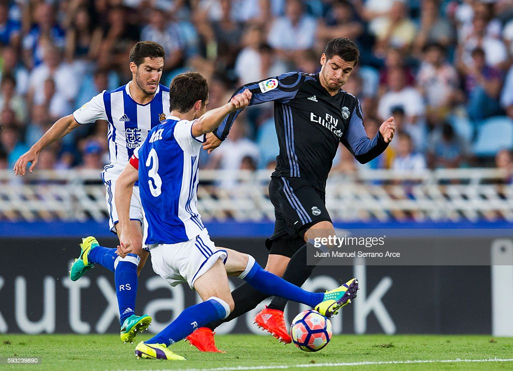 Alvaro Morata of Real Madrid duels for the ball with Mikel Gonzalez of Real Sociedad during the La Liga match between Real Sociedad de Futbol and...
