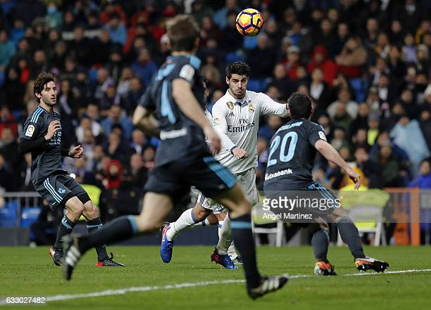 Alvaro Morata of Real Madrid heads the ball to score his team's third goal during the La Liga match between Real Madrid and Real Sociedad at Estadio...