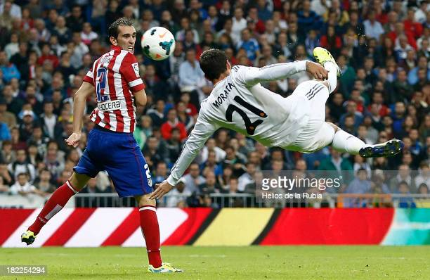 Alvaro Morata of Real Madrid in action against Diego Godín of Atletico de Madrid during the La Liga match between Real Madrid and Club Atletico de...
