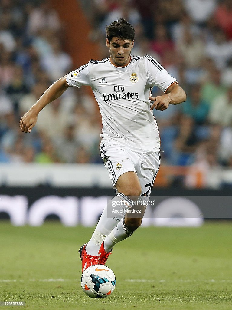 <a gi-track='captionPersonalityLinkClicked' href=/galleries/search?phrase=Alvaro+Morata&family=editorial&specificpeople=6523866 ng-click='$event.stopPropagation()'>Alvaro Morata</a> of Real Madrid in action during the La Liga match between Real Madrid CF and Real Betis at Estadio Santiago Bernabeu on August 18, 2013 in Madrid, Spain.