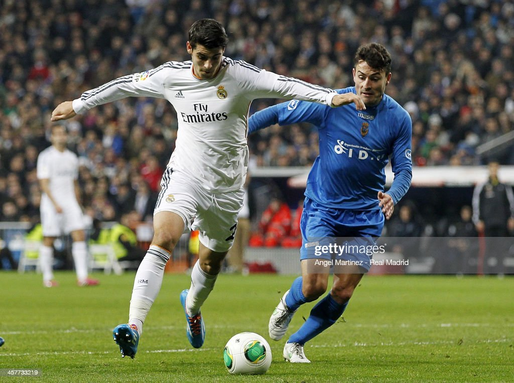 <a gi-track='captionPersonalityLinkClicked' href=/galleries/search?phrase=Alvaro+Morata&family=editorial&specificpeople=6523866 ng-click='$event.stopPropagation()'>Alvaro Morata</a> of Real Madrid is chased by Pepin of Olimpic de Xativa during the Copa del Rey, round of 32 match between Real Madrid and Olimpic de Xativa at Estadio Santiago Bernabeu on December 18, 2013 in Madrid, Spain.