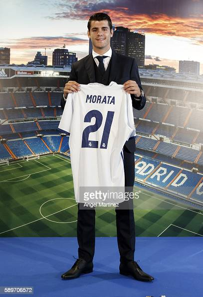 Alvaro Morata of Real Madrid poses during his official presentation at Estadio Santiago Bernabeu on August 15 2016 in Madrid Spain