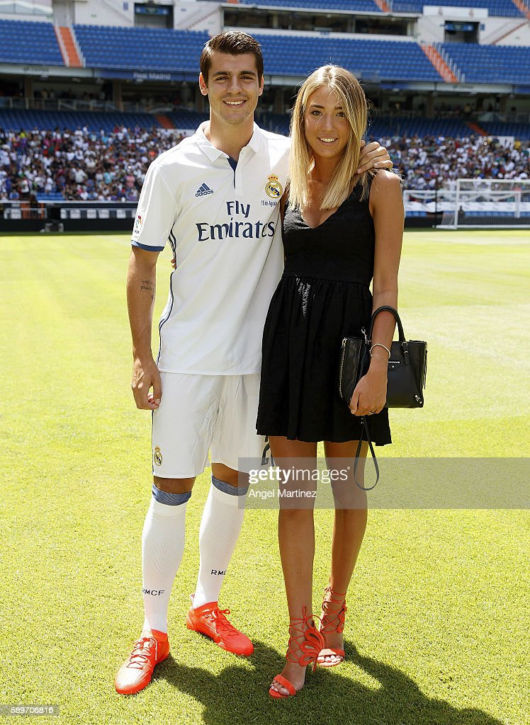 Alvaro Morata (L) of Real Madrid poses with his girlfriend Alice Campello during his official presentation at Estadio Santiago Bernabeu on August 15, 2016 in Madrid, Spain.