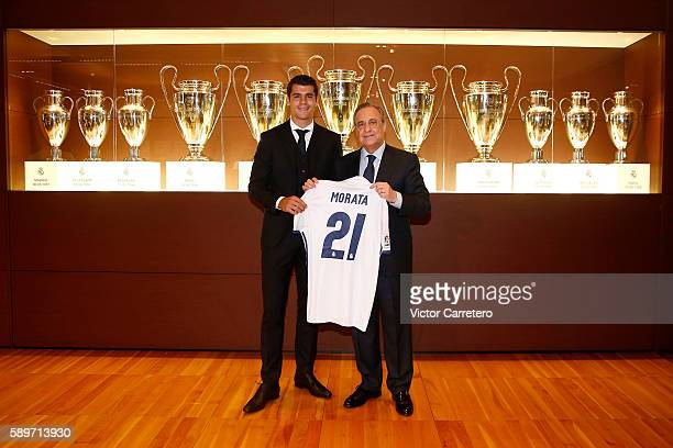Alvaro Morata of Real Madrid poses with Real Madrid president Florentino Perez during his official presentation at Estadio Santiago Bernabeu on...