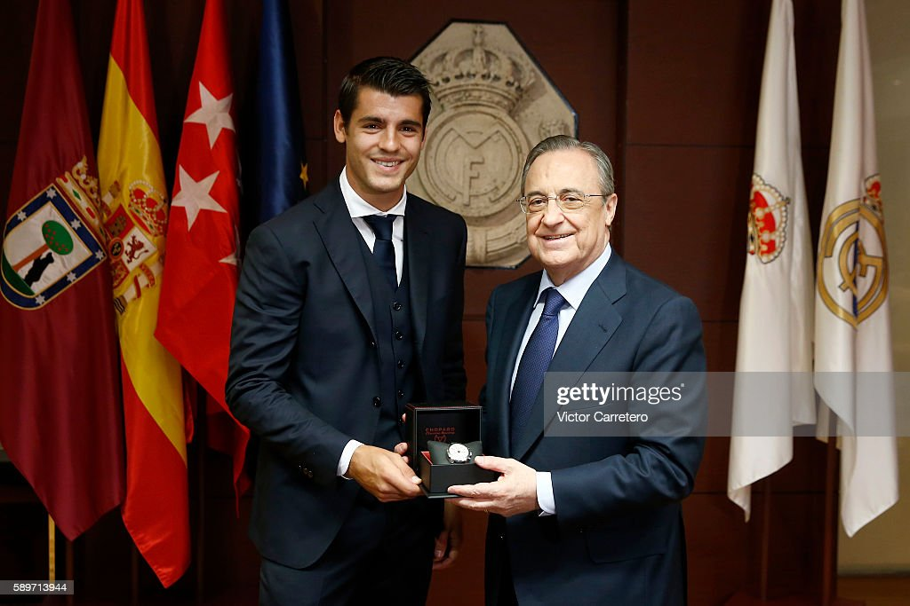 Alvaro Morata (L) of Real Madrid poses with Real Madrid president Florentino Perez during his official presentation at Estadio Santiago Bernabeu on August 15, 2016 in Madrid, Spain.