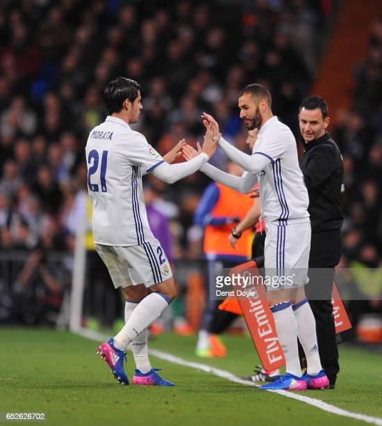 Alvaro Morata of Real Madrid salutes teammate Karim Benzema after coming off during the La Liga match between Real Madrid CF and Real Betis Balompie...
