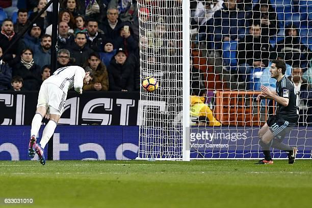 Alvaro Morata of Real Madrid scores his team's third goal during the La Liga match between Real Madrid and Real Sociedad at Estadio Santiago Bernabeu...