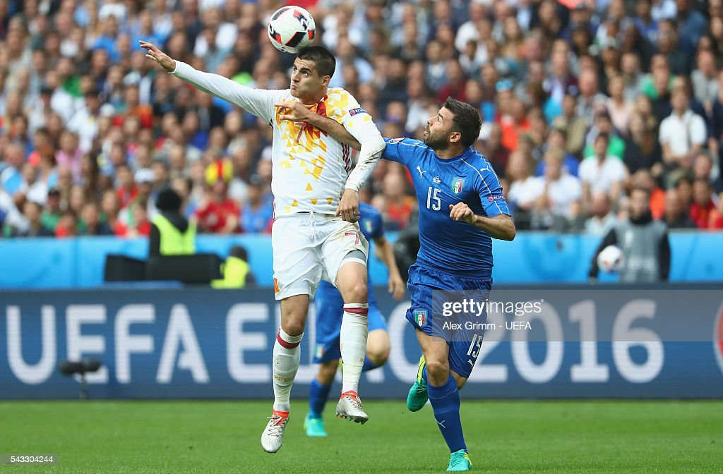 <a gi-track='captionPersonalityLinkClicked' href=/galleries/search?phrase=Alvaro+Morata&family=editorial&specificpeople=6523866 ng-click='$event.stopPropagation()'>Alvaro Morata</a> of Spain and <a gi-track='captionPersonalityLinkClicked' href=/galleries/search?phrase=Andrea+Barzagli&family=editorial&specificpeople=465353 ng-click='$event.stopPropagation()'>Andrea Barzagli</a> of Italy compete for the ball during the UEFA EURO 2016 round of 16 match between Italy and Spain at Stade de France on June 27, 2016 in Paris, France.