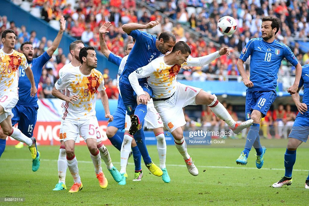 Alvaro Morata of Spain and Giorgio Chiellini of Italy during the European Championship match Round of 16 between Italy and Spain at Stade de France on June 27, 2016 in Paris, France.
