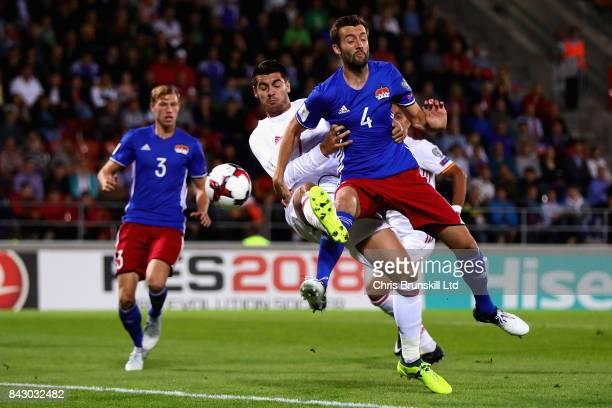 Alvaro Morata of Spain attempts a shot as Daniel Kaufmann of Liechtenstein attempts to block during the FIFA 2018 World Cup Qualifier between...