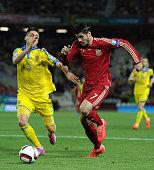 Alvaro Morata of Spain battles for the ball against Yevhen Khacheridi of Ukraine during the Spain v Ukraine EURO 2016 Qualifier at Estadio Ramon...