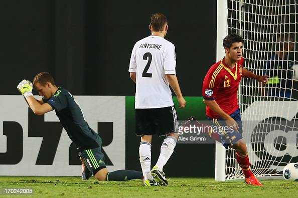 Alvaro Morata of Spain celebrates his team's winning goal as Tony Jantschke and goalkeeper Bernd Leno of Germany react during the UEFA European U21...
