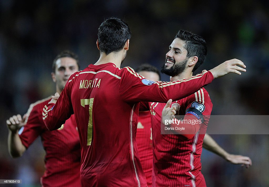 Alvaro Morata of Spain celebrates with Isco Alarcon after scoring Spain's opening goal during the Spain v Ukraine EURO 2016 Qualifier at estadio...