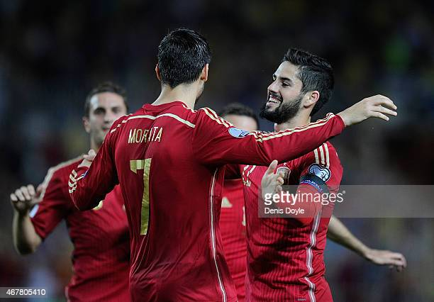 Alvaro Morata of Spain celebrates with Isco Alarcon after scoring Spain's opening goal during the Spain v Ukraine EURO 2016 Qualifier at estadio...