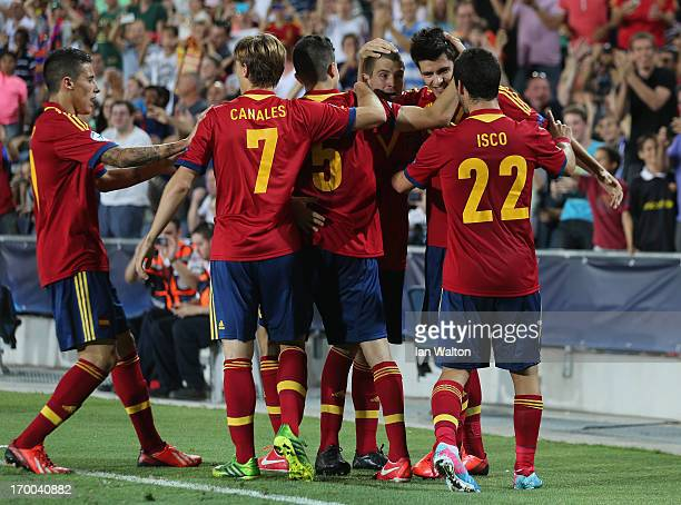 Alvaro Morata of Spain celebrates with Isco and teammates after scoring the opening goal of the UEFA European U21 Championships Group B match between...