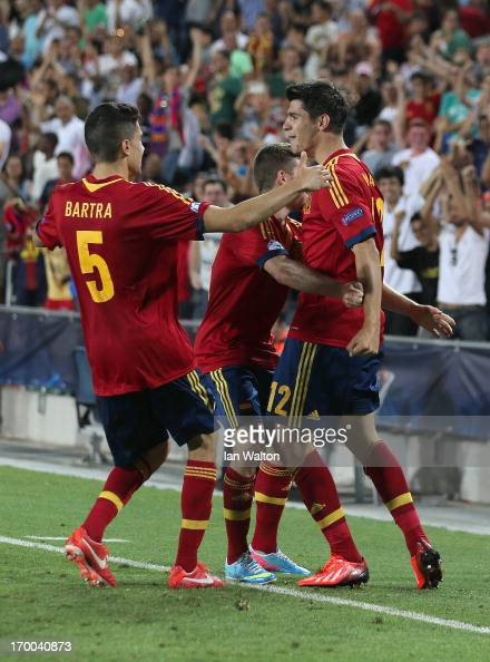 Alvaro Morata of Spain celebrates with Marc Bartra and teammates after scoring the opening goal of the UEFA European U21 Championships Group B match...