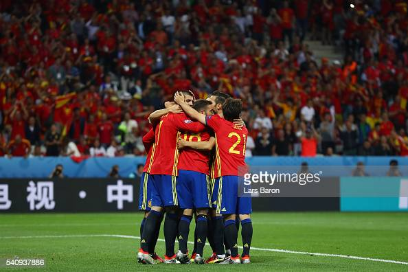 Alvaro Morata of Spain celebrates with team mates after scoring his second and his sides third goal during the UEFA EURO 2016 Group D match between...