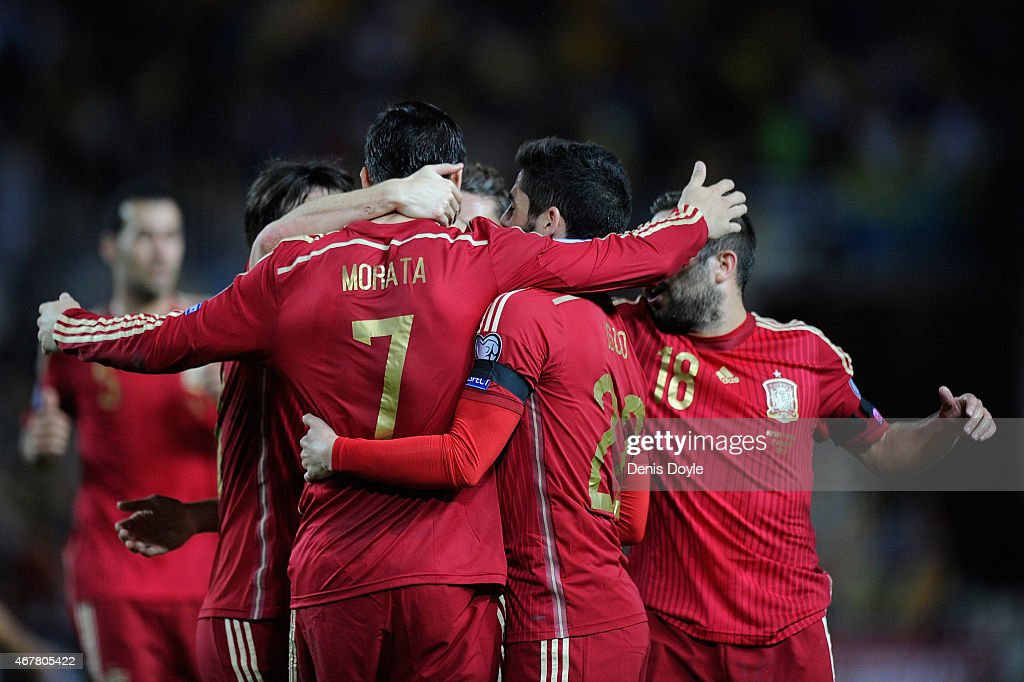 Alvaro Morata of Spain celebrates with teammates after scoring Spains opening goal during the Spain v Ukraine EURO 2016 Qualifier at estadio Ramon...