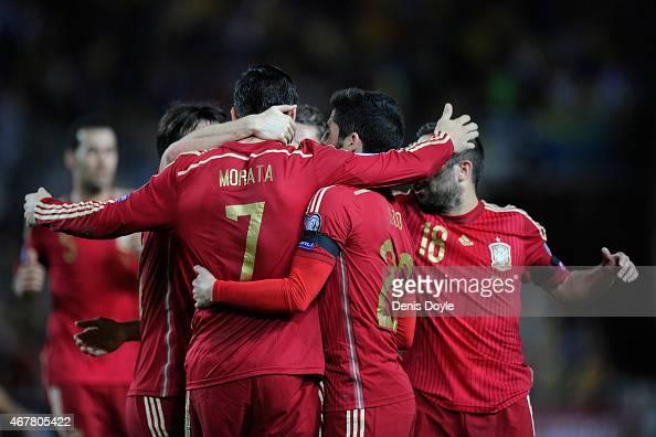 Alvaro Morata of Spain celebrates with teammates after scoring Spains opening goal during the Spain v Ukraine EURO 2016 Qualifier at estadio Ramon...