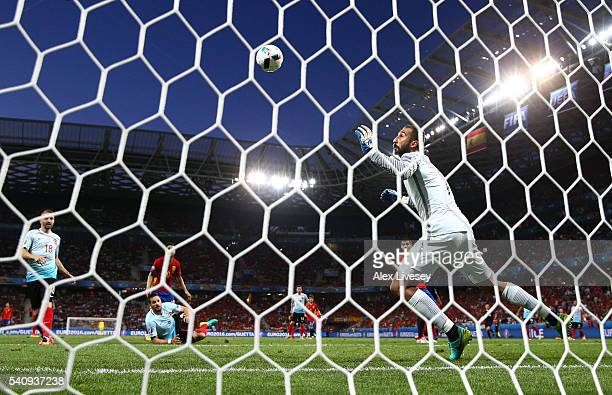Alvaro Morata of Spain heads the ball past Volkan Babacan of Turkey to score his sides first goal during the UEFA EURO 2016 Group D match between...