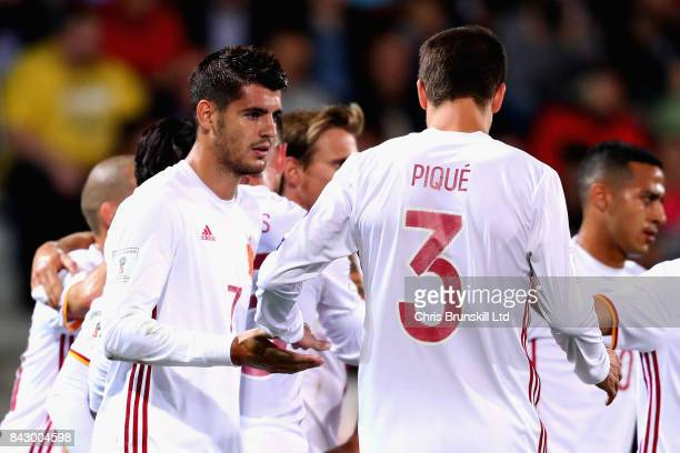 Alvaro Morata of Spain is congratulated by teammate Gerard Pique after scoring his sides second goal during the FIFA 2018 World Cup Qualifier between...