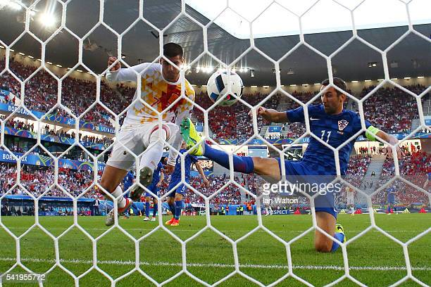 Alvaro Morata of Spain scores the opening goal during the UEFA EURO 2016 Group D match between Croatia and Spain at Stade Matmut Atlantique on June...