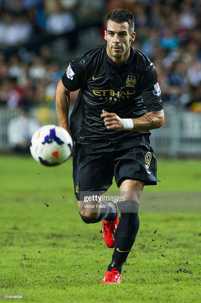 Alvaro Negrado of Manchester City runs with the ball during the Barclays Asia Trophy Semi Final match between Manchester City and South China at Hong Kong Stadium on July 24, 2013 in So Kon Po, Hong Kong.