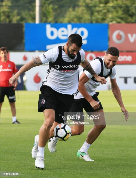 Alvaro Negredo and Dusko Tosic of Besiktas attend a training session ahead of the Turkish Spor Toto Super Lig new season match between Besiktas and...