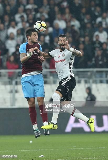 Alvaro Negredo of Besiktas vies with Okay Yokuslu of Trabzonspor during the Turkish Super Lig soccer match between Besiktas and Trabzonspor at...