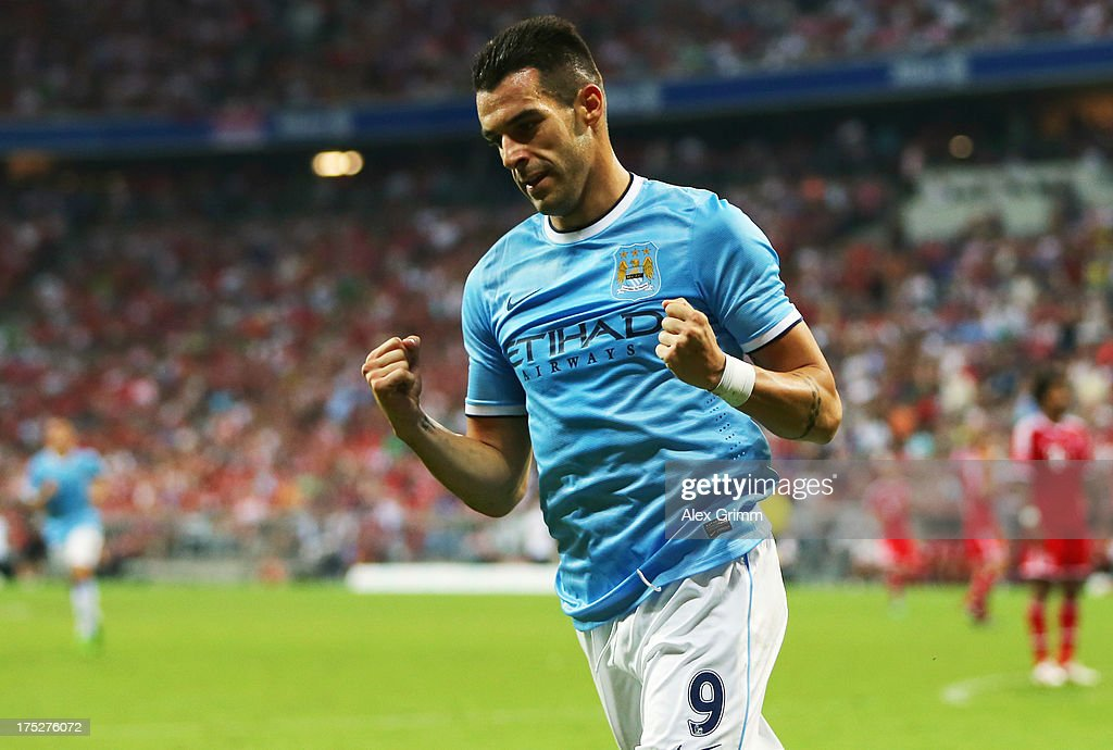 <a gi-track='captionPersonalityLinkClicked' href=/galleries/search?phrase=Alvaro+Negredo&family=editorial&specificpeople=4085785 ng-click='$event.stopPropagation()'>Alvaro Negredo</a> of Manchester celebrates his team's first goal during the Audi Cup Final match between FC Bayern Muenchen and Manchester City at Allianz Arena on August 1, 2013 in Munich, Germany.